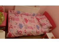 Pink toddler bed with bedside table