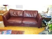 4 seater brown leather sofa in good condition.
