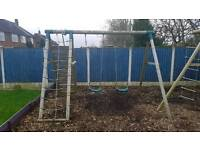 Plum double swing with climbing frame