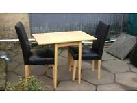 Small table and 2 leather chairs