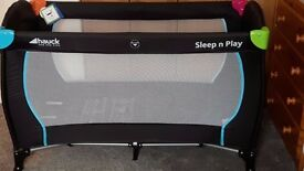 'hauk' sleep n play travel cot, the larger size. Plus a chair for eating at the table.