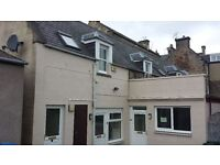 Spacious 2 bedroom flat, Forres town centre, recently renovated. Free parking.