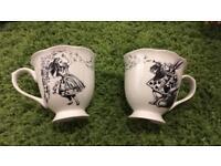 Beautiful pair of Alice in Wonderland mugs