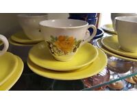 White and Yellow Teacups and Saucers