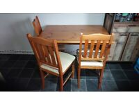 Used pine dining table and 4 chairs