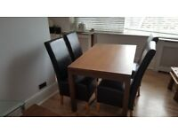 Dining table witch leather chairs