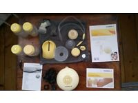Medela Swing breast pump and accessories, smoke/pet free home, only used a few times