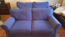 Alstons 2 seater sofa (Blue). Original unused cushions. Non smoking. No Pets. Good condition.