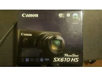 Canon SX610 digital camera + 2 batteries & carrying case