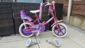 Raleigh girls bike with stabilizers