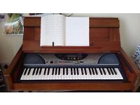 Handcrafted wooden case with Yamaha PSR-240