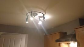 Ceiling light. Chrome with 4 adjustable spot lights. Suitable for kitchen or dining room