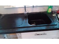 black composite single bowl kitchen sink and taps