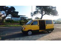 2001 Volkswagen Transporter T4 Van camper with side and rear windows.
