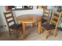 Dining Table and 4 chairs. Oak Finish.