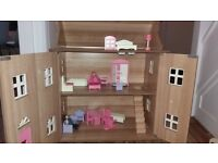 Wooden dolls house for sale.