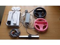 Nintendo Wii - With two Wii Remotes, controller, sensor bar, adapter, two steering wheels, and cable
