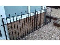 Wrought iron drive gates.