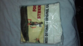 SALE-££-SALE TWO COLLECTIBLE-GENUINE GUINESS T SHIRTS STILL IN ORIGINAL PACKAGING FOR SALE