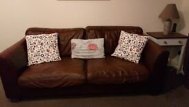 2x large brown leather sofas