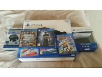PS4 500 GB hardly used, with original boxes and extra controller, docking station and five games