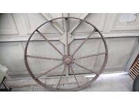"Pair 42"" iron decorative wheels"
