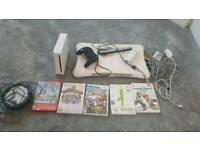Wii console, games and balance board.