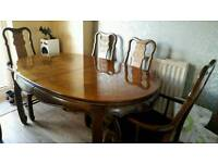 Traditional extendable wooden dining table