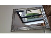 Large silver wall mirror.