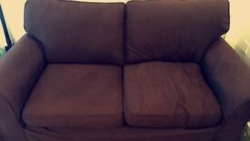 Brown two seater sofa bed