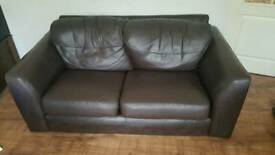 Leather sofa and matching chair in chocolate