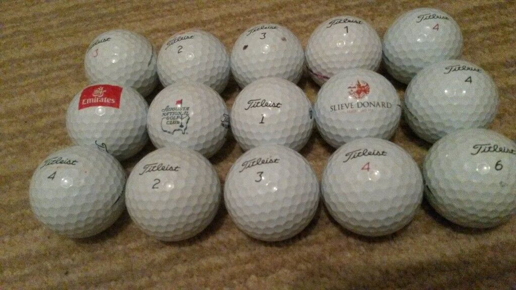 15 Pro vs golf balls in excellent condition some with logos.