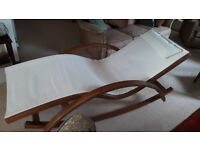 Rocking lounge chair £50 ono. VGC Used 5 times indoors. Brown wood with white fabric.
