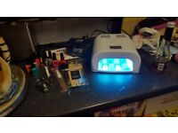 36w gel nail lamp and 12 polishes loads of accessories ect...