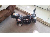 12v kids black electric 3 wheel bike. Barely used