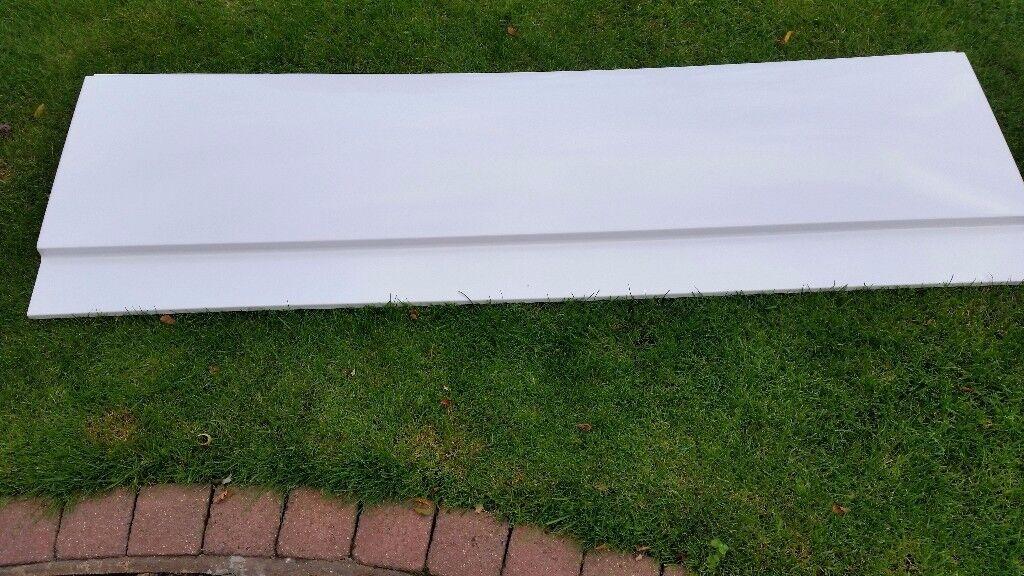 A white unused brand new bath side panel