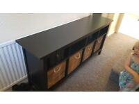 Black Ikea storage sideboard with boxes