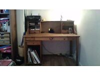 Desk from Ikea in antique pine with additional pull out storage unit.