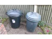 Two plastic dustbins