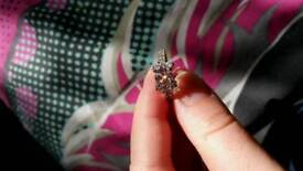 Pink sapphire and topaz ring