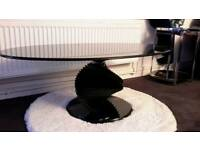 Black oval glass coffee table.Unique modern design.