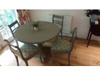 Beautiful and chic dining table and four chairs. Annie Sloan chalk paint.