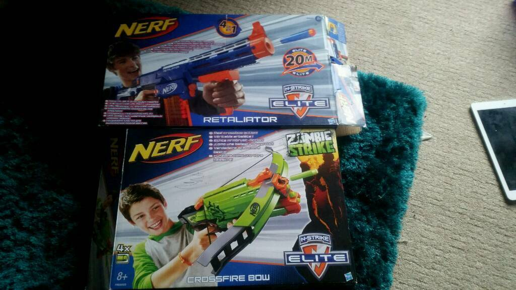 2 nurf guns with an extra one bullet pump action pistol
