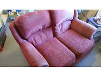 Red two-seat sofa going for free