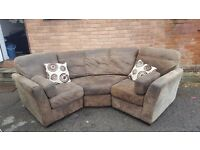 Comfy brown suede curved corner sofa. can deliver