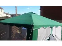 For sale large gazebo green in colour with white netting doors
