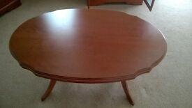 Oval mahogany finish coffee table