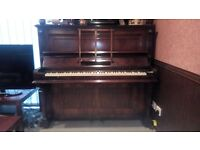 Upright piano in good condition, free to who will collect