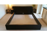 This IKEA Malm king size bed is in black and comes with all its original requirements