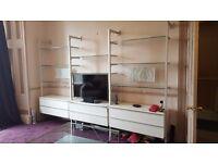 IKEA ANGA unit. White, glass and brushed chrome living room storage and display unit.